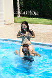 Couple in swimming pool. Couple having fun in swimming pool Royalty Free Stock Photo