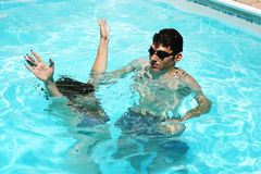 Couple in swimming pool. Couple having fun in swimming pool Royalty Free Stock Image