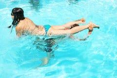 Couple in swimming pool. Couple having fun in swimming pool Royalty Free Stock Photos