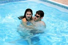 Couple in swimming pool. Couple having fun in swimming pool Stock Photos