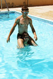 Couple in swimming pool. Couple having fun in swimming pool Royalty Free Stock Images