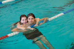 Couple in a swimming pool Royalty Free Stock Photo