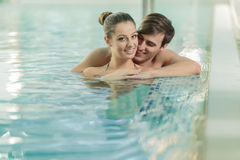 Couple in the swimming pool Stock Photography