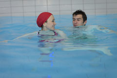 Couple in swimming pool Royalty Free Stock Image