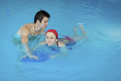 Couple in swimming pool Royalty Free Stock Photos