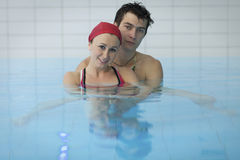 Couple in swimming pool Royalty Free Stock Images