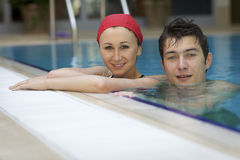 Couple in swimming pool Royalty Free Stock Photography