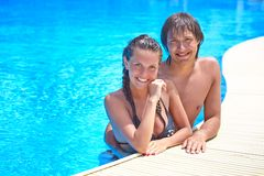 Couple in swimming pool Stock Photos