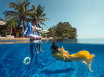 Couple in the swimming pool Stock Images