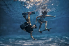 Couple in the swimming pool Royalty Free Stock Images