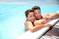 Couple in swimming pool Stock Photo