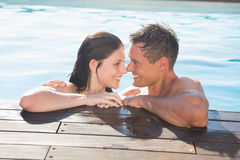 Couple in swimming pool on a sunny day Stock Photos