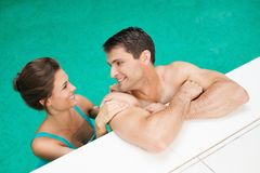 Couple in a swimming pool Royalty Free Stock Photography