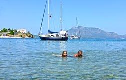 Couple swimming in sea Stock Image