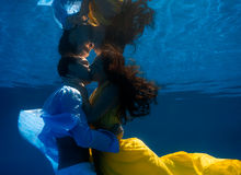 Couple swimming underwater Stock Photo
