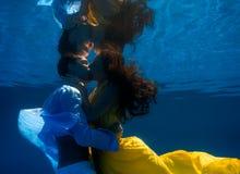 Couple swimming underwater Stock Photo