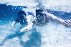 Couple swims or snorkeling underwater royalty free stock photos
