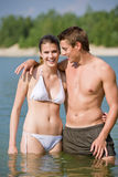Couple in swimwear enjoy water and sun Royalty Free Stock Images