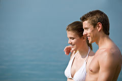 Couple in swimwear enjoy water and sun at sea Stock Image