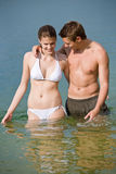Couple in swimwear enjoy water and sun in summer Stock Photos