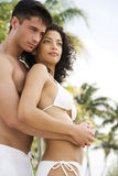 Couple in swimwear on tropical holiday, drinking champagne Royalty Free Stock Photos