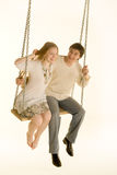 Couple on a swing. On a white background Stock Photography