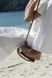Couple on swing at beach Stock Photo