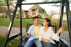 Couple on swing royalty free stock images