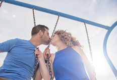 Couple on swings Royalty Free Stock Image