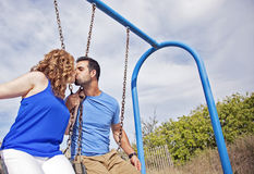 Couple on swings Royalty Free Stock Photos