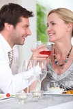 Couple at a table. Couple enjoying a meal at the table Stock Images