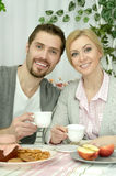 Couple at table with coffee and food Royalty Free Stock Photo