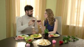 Couple at table drinking wine. stock footage