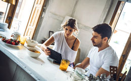 Couple with tablet during breakfast Royalty Free Stock Images