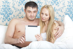 Couple with tablet computer Stock Image