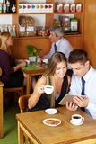 Couple with tablet computer in café Royalty Free Stock Photography