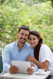 Couple with tablet computer Stock Photo