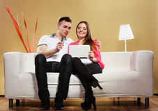 Couple with tablet and credit card at home buying Stock Photos