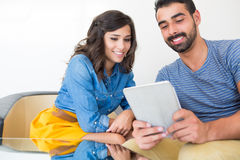 Couple with tablet Stock Images