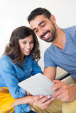 Couple with tablet Stock Photos