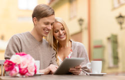 Couple with tablet pc in cafe Royalty Free Stock Images