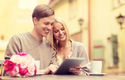 Couple with tablet pc in cafe Royalty Free Stock Image