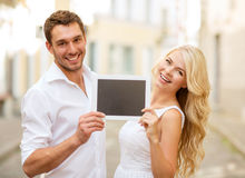 Couple with tablet pc in the city Royalty Free Stock Photography