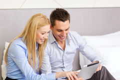 Couple with tablet pc computer in hotel room Stock Photo