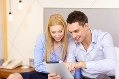 Couple with tablet pc computer in hotel room Stock Photography