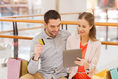 Couple with tablet pc and credit card in mall Stock Images