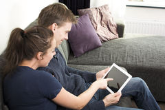 Couple on tablet pc. A European looking couple on a tablet pc stock image