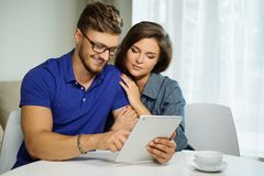Couple with tablet pc at home Royalty Free Stock Photos