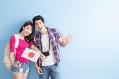 Couple take japan flag. Young couple take japan flag and smile happily stock photos