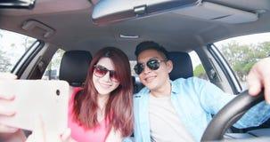 Couple take selfie in car stock photo